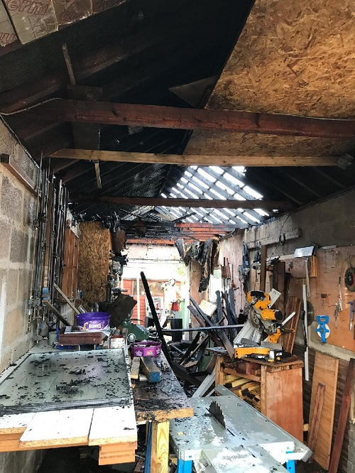 Man treated in hospital after garage fire