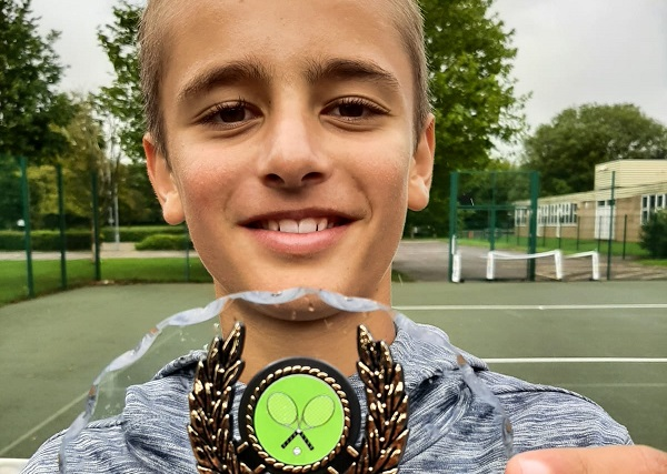 Zechariah takes under-18s tennis title - aged just 13